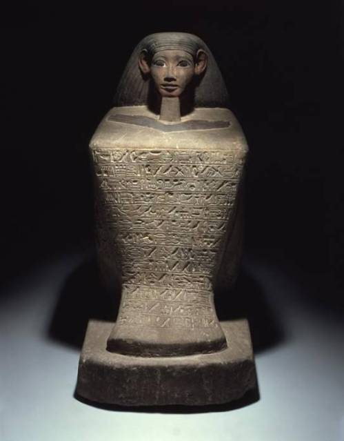 This Egyptian statue from 1479-1458 BCE is made of sandstone, and pigment remains on the wig, face and hands.