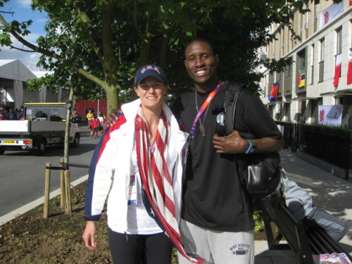 Gold medal winner Susan Francia C'04 G'04, and Koko Archibong C'03, stopped to pose together in the Olympic Village earlier this week