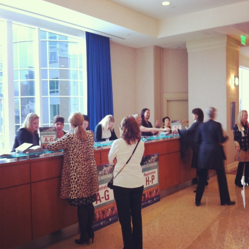 Attenees check-in at the registration desk at the Loews Hollywood Hotel