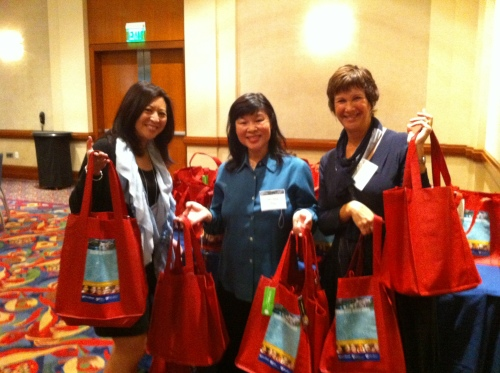 Volunteers distribute the bags to conference attendees.