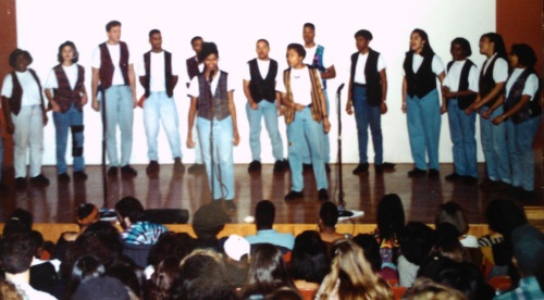 Performing with The Inspiration in the Vest and Jeans Combo, another '90s classic.