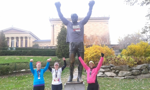 After the race in front of the Rocky statues; Graduate Student Center; stack of books I'm using for research projects?
