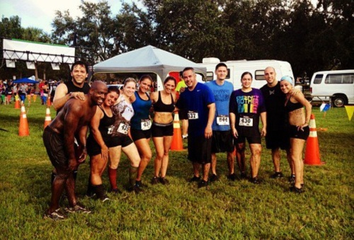 "Steve (far left, shirtless) & Lucy (in ""Don't Bother Me"" shirt) in the 2012 Mud Run with part of their CrossFit Siege family."