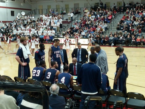 The Penn Men's Basketball team during a time out at Harvard.