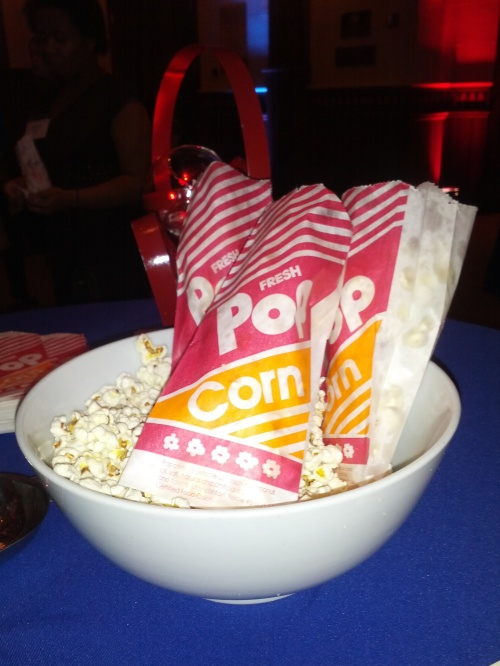 Caption: The blue table linens complemented the red popcorn bags so nicely. I see red and blue everywhere!
