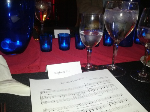 "Each table setting included sheet music for ""Drink A Highball"". While it was neat to see the sheet music, the printout was unnecessary. All of the class leaders knew the song by heart."