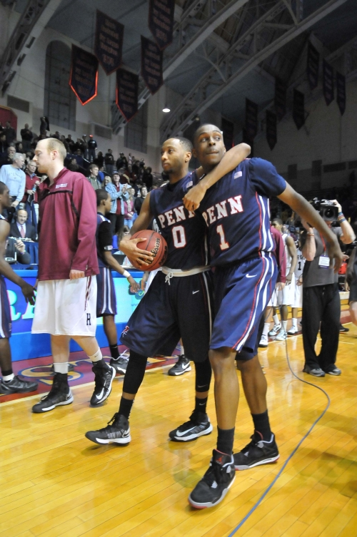 Junior guard Miles Cartwright (left) and freshman guard Tony Hicks walk off victorious after combining for 36 points in a 75-72 upset over Harvard Saturday. From the DP. Photo credit: Andrew Dierkes
