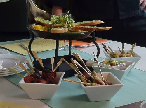 Deconstructed Paella Station - paella rice, grilled organic chicken, shrimp, chorizo, and grilled spring vegetable salad, sliced French bread.
