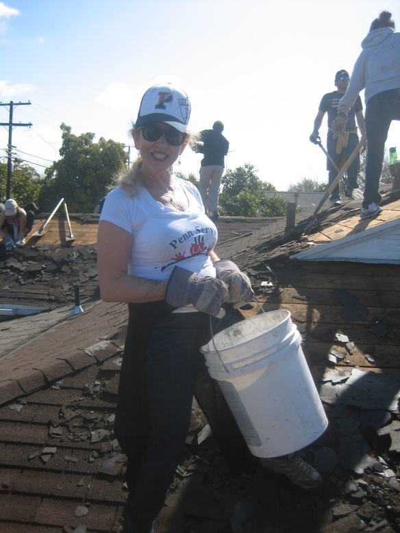 Penn Serves LA founder Jane Gutman helping to remove the roof Habitat for Humanity Los Angeles