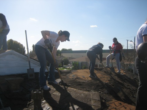 Penn Serves LA volunteers hard at work taking off the roof.