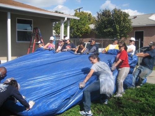 The tarp was really heavy for Penn Serves LA volunteers Habitat for Humanity Los Angeles