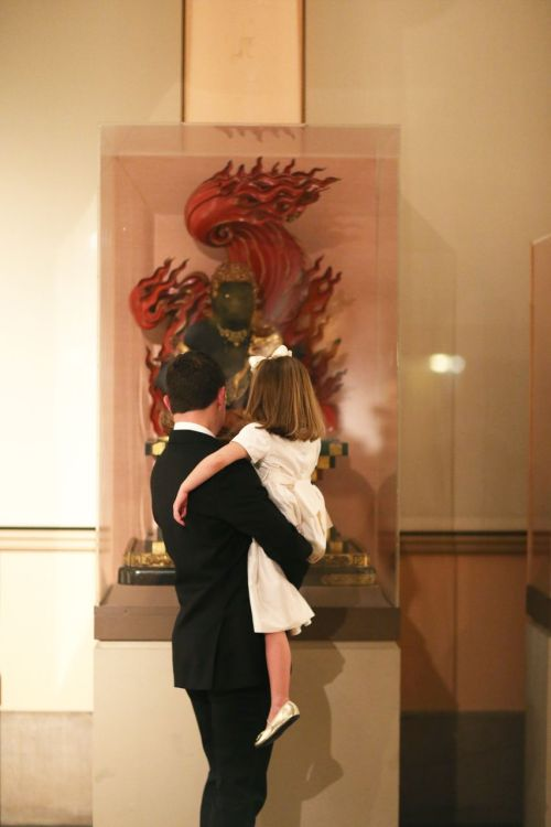 The flower girl and her father take in the many artifacts. Photo credit: Alison Conklin Photography