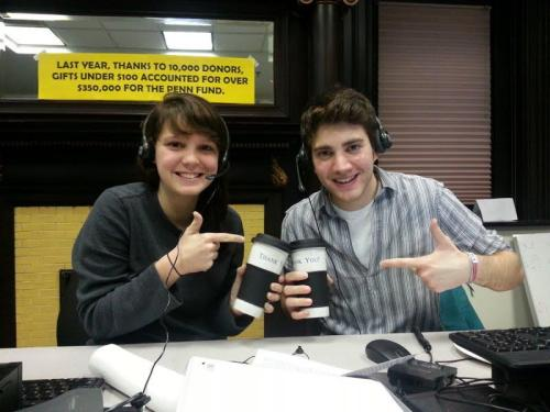 Taryn (left) with caller Michael thanking The Penn Fund for the AWESOME coffee mugs!
