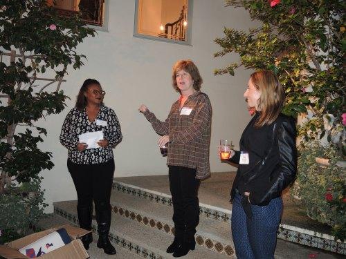 Julie Platt welcomes everyone while Lolita Jackson, ENG'89, and Beth Kean, ENG'89, look on.