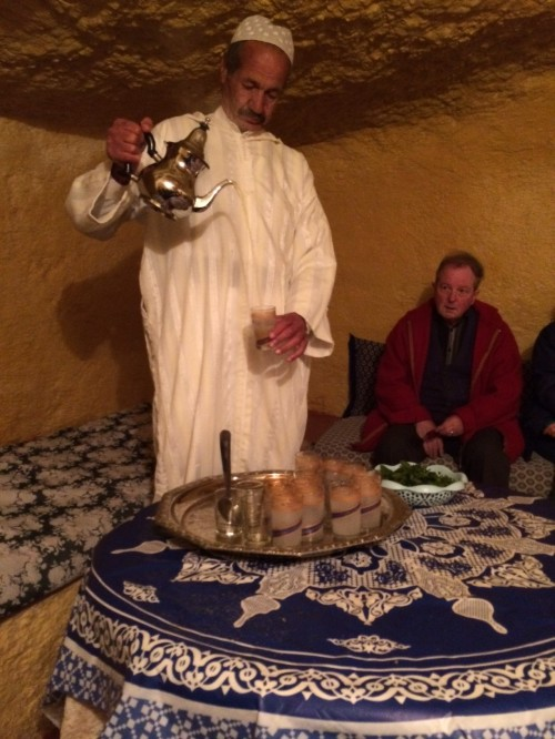 Muhammad pours mint tea from a great height.