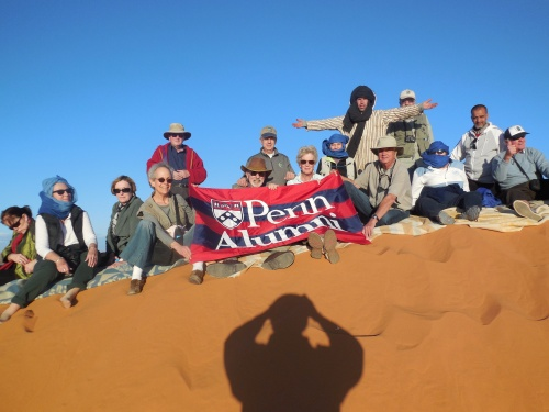 Penn alumni and friends at the top of the dune.