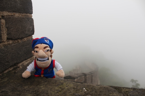 A visit to China is not complete without a visit to the Great Wall. The Quaker scales the wall.