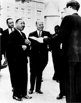 "Dr. Martin Luther King, Jr. is greeted at the University Museum on ""Law Day USA"", May 1, 1965. (Photo by Bernato, courtesy the University Archives)"
