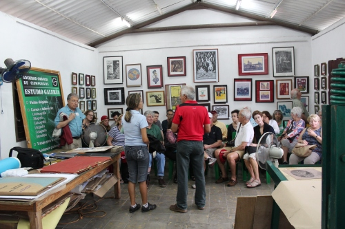 Conversations in a graphic art studio in Cienfuegos, Cuba.