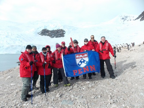 Happy Penn alumns and friends on the Antarctic continent (check out the penguins in the back).