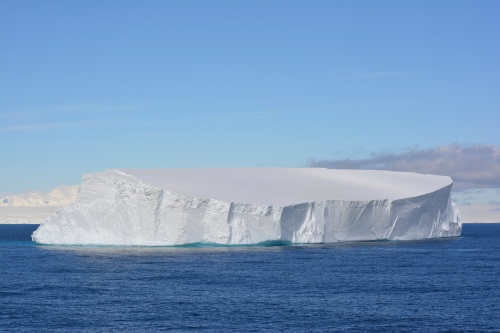 Tabular iceberg calved from the Ice Shelf in the Weddell Sea. Some of these icebergs originate from the recent, climate-warming induced disintegration of the West Antarctic peninsula.