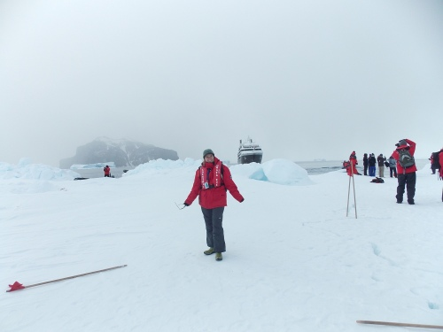 "Standing on sea-ice in the Weddell Sea, with our ship ""L'Austral"" in the background."