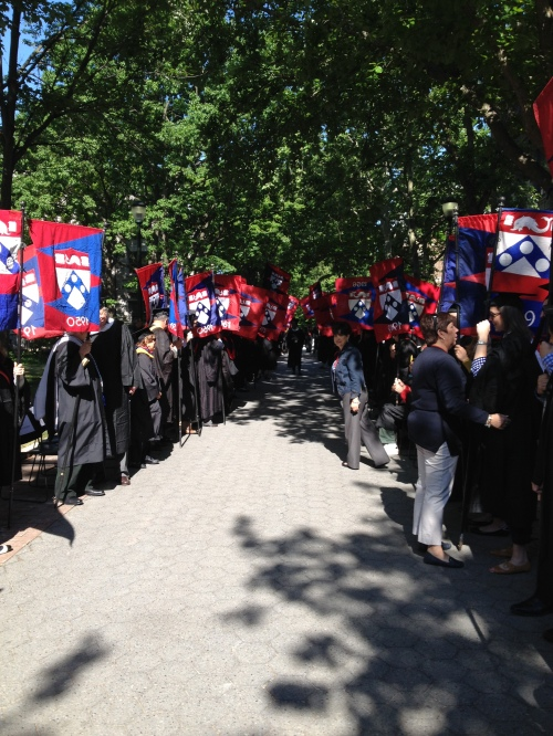 Alumni flag bearers line Locust Walk to congratulate the newest Penn Alumni!