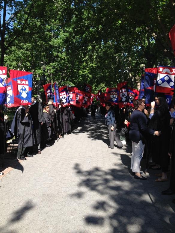 Alumni flag bearers line Locust Walk to congratulate the newest Penn Alumni!
