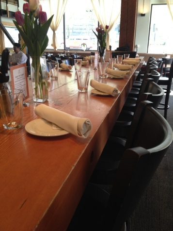 The tables are set for FareStart's Guest Chef Night, with Penn Alumni Club of Seattle members as guest servers.