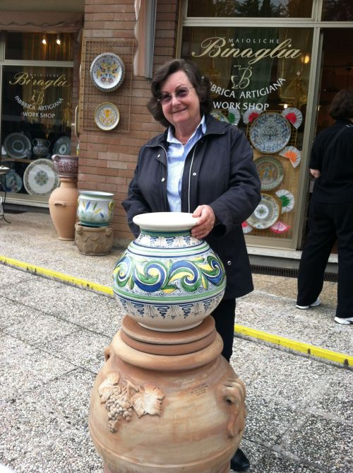 Enrica, our tour director, shows off some of the wares in Deruta.