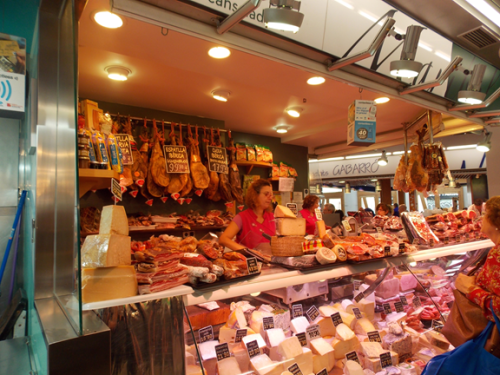 A cured meat and cheese stand in La Boqueria, the premiere public market in Barcelona.
