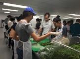 Penn Serves LA chopping green beans at L.A. Kitchen