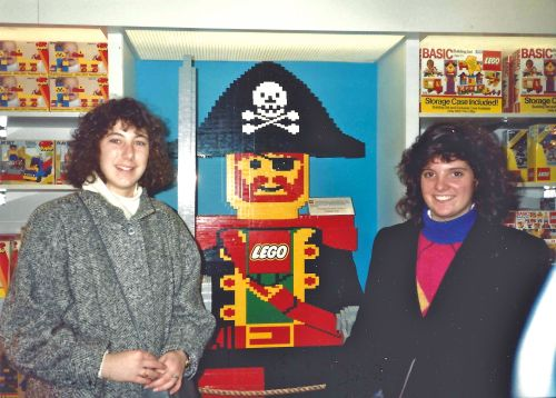Lisa Bardfeld Shapiro, C'93, and Regan Allan, C'93, at the Lego display in FAO Schwartz.