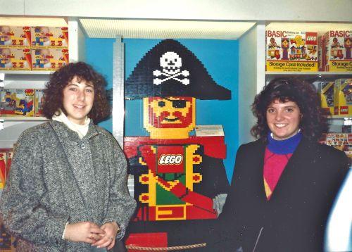 Lisa Bardfeld Shapiro, C'93, and Regan Allan, C'93, at the Lego display in FAO Schwartz.