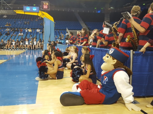 Penn Cheerleaders and the Quaker sit in front of the Penn Band during the game, photo credit Aileen Level, C'99, GED'00