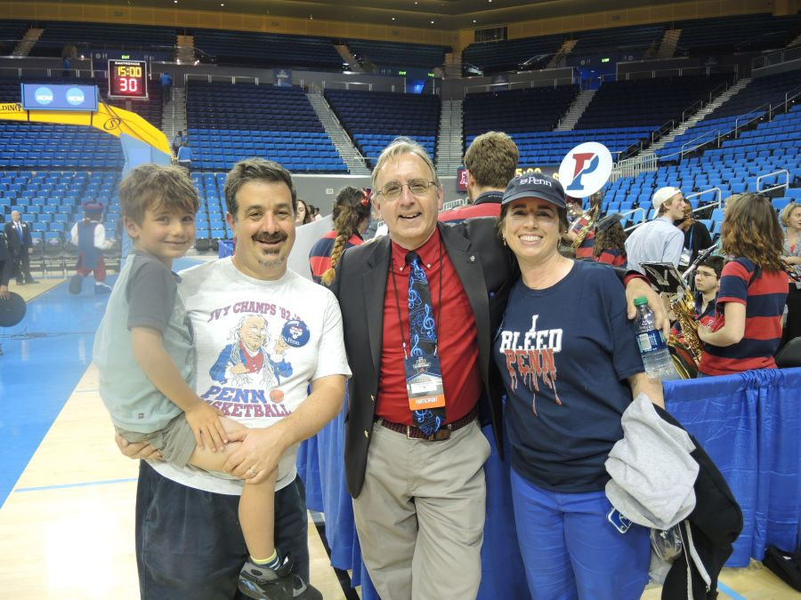 Mitchell Kraus, C'93, with his son, and I pose with Penn Band Director Greer Cheeseman, EAS'79