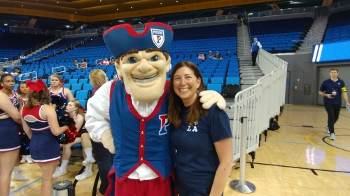 Lisa Niver, C'89, with the Quaker at Pauley Pavilion UCLA for NCAA Women's Basketball tournament