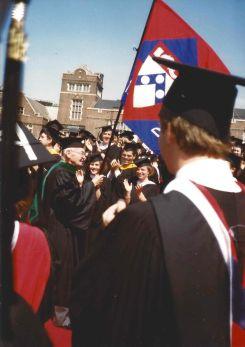 Graduates cheer for the Alumni Procession