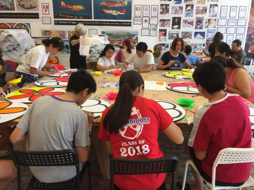 Penn Alumni and Penn Serves LA painting flowers at Portraits of Hope