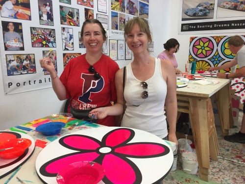 Penn Serves LA board members Kiera Reilly, C'93, and Jaime Kendall, W'04 paint a flower