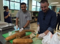 Penn Serves LA volunteers preparing a meal at Dolores Mission Parish's Guadalupe Shelter