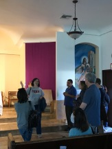 Ellie Hidalgo C'87 gives Penn Serves volunteers a tour of the Dolores church