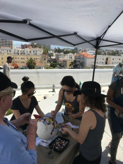 Penn Serves LA makes mosaics for The Skid Row Housing Trust volunteering Los Angeles