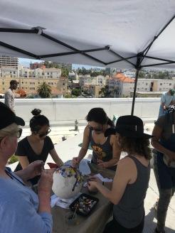 Penn Serves LA makes mosaics for The Skid Row Housing Trust volunteering Los Angeles